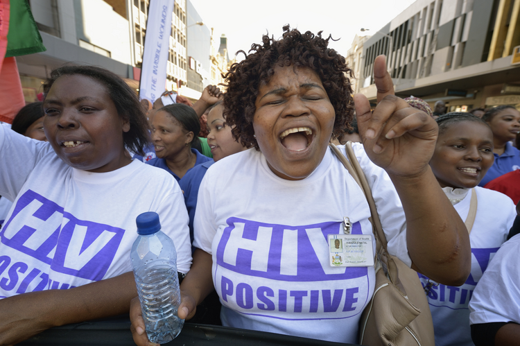 Demonstrators march through the streets of Durban, South Africa, on July 18, demanding better funding for HIV and AIDS treatment around the world. (CNS photo/Paul Jeffrey)