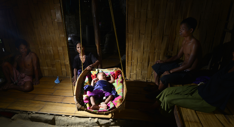 A Bru refugee family is seen in Kanchanpur, India on June 18. (CNS photo/Stringer, EPA)