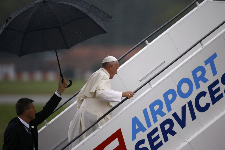 Pope Francis enters a plane following the July 31 World Youth Day farewell ceremony at John Paul II International Airport in Krakow, Poland. (CNS photo/Kacper Pempel, Reuters)