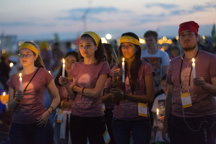 Some Practices Prove Sticky. World Youth Day pilgrims hold candles during eucharistic adoration with Pope Francis at the July 30 prayer vigil at the Field of Mercy in Krakow, Poland. (CNS photo/Jaclyn Lippelmann, Catholic Standard)