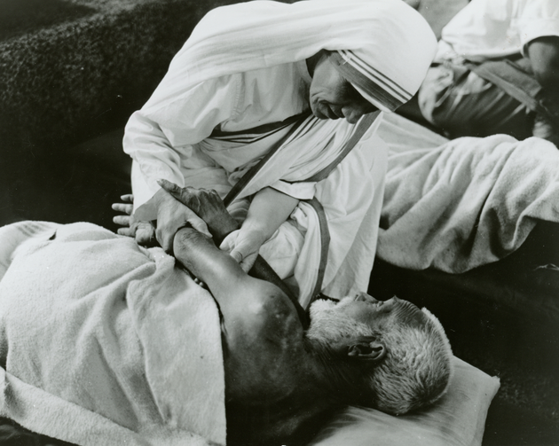 Blessed Teresa of Kolkata cares for a sick man in an undated photo. (CNS photo/KNA)