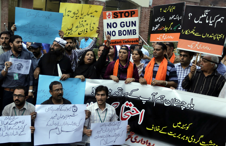 Pakistani journalists in Lahore, Pakistan, protest a bombing Aug. 8 that killed at least 70 people in Quetta. (CNS photo/Rahat Dar, EPA)