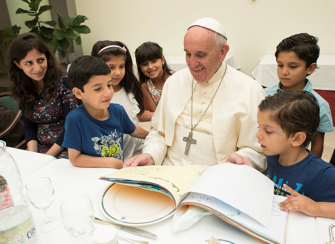 Pope Francis sits with refugee children from Syria at the Vatican Aug. 11. (CNS photo/L'Osservatore Romano via Reuters)