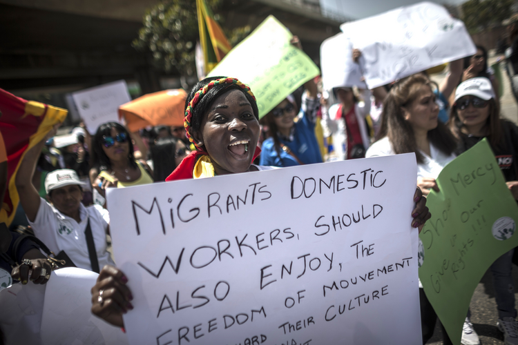 Women protest for better wages and working conditions for migrant domestic workers in Beirut May 1. Pope Francis prayed for all exploited women and girls during the feast of the Assumption at the Vatican Aug. 15. (CNS photo/Oliver Weiken, EPA)