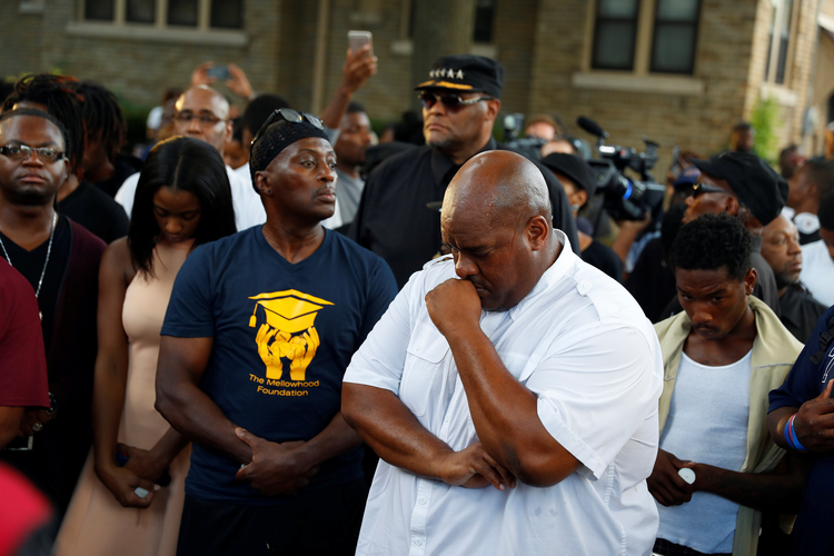 Community members attend a vigil Aug. 15 following the police shooting of a man in Milwaukee the previous day. (CNS photo/Aaron P. Bernstein, Reuters)