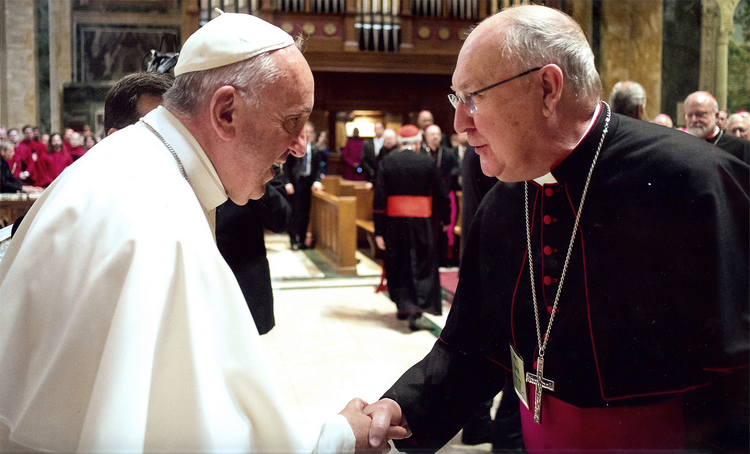 Pope Francis greets Bishop Kevin J. Farrell of Dallas in Washington in September 2015. Pope Francis has named the Texas bishop to head the Vatican's new office for laity, family and life. (CNS photo/courtesy The Texas Catholic)