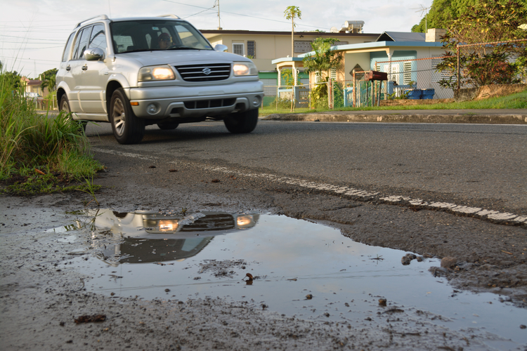 Puddle Warning. A street puddle is seen in San German, Puerto Rico, in this undated photo. Puddles of water contribute to the spread of Zika in Puerto Rico. (CNS photo/CNS photo/Wallice J. de la Vega)