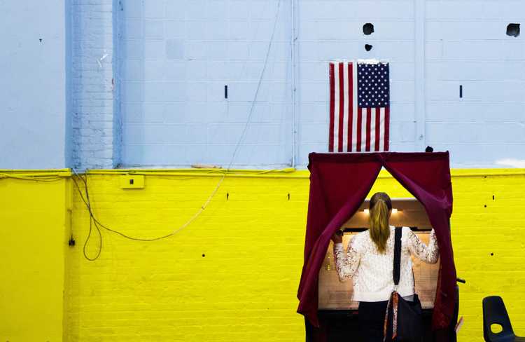 A woman enters a voting booth in Hoboken, N.J., June 7. (CNS photo/Justin Lane, EPA)