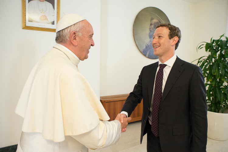Thumbs Up. Pope Francis meets Mark Zuckerberg, CEO of Facebook, during a private audience at the Vatican Aug. 29. (CNS photo/L'Osservatore Romano, handout)