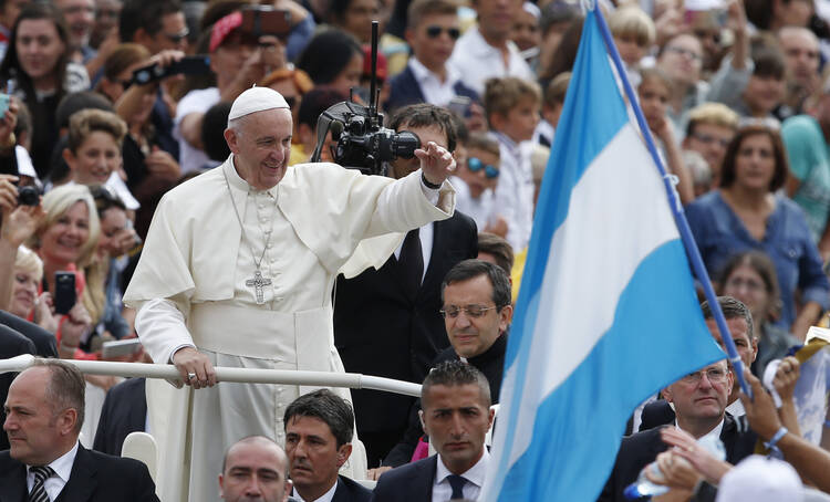 Argentina's flag is seen as Pope Francis arrives to lead his general audience in St. Peter's Square at the Vatican on Sept. 7. (CNS photo/Paul Haring)
