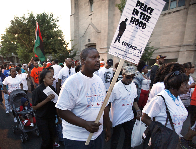 Participants walk during a call for an end to violence in their community June 17 in Chicago. The march followed a rally in front of St. Sabina Church. (CNS photo/Karen Callaway)