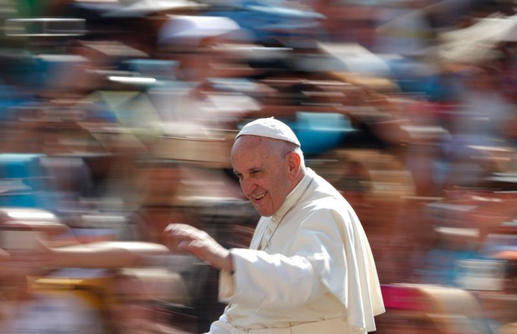 Pope Francis arrives to lead his general audience in St. Peter's Square at the Vatican Sept. 14. (CNS photo/Paul Haring)