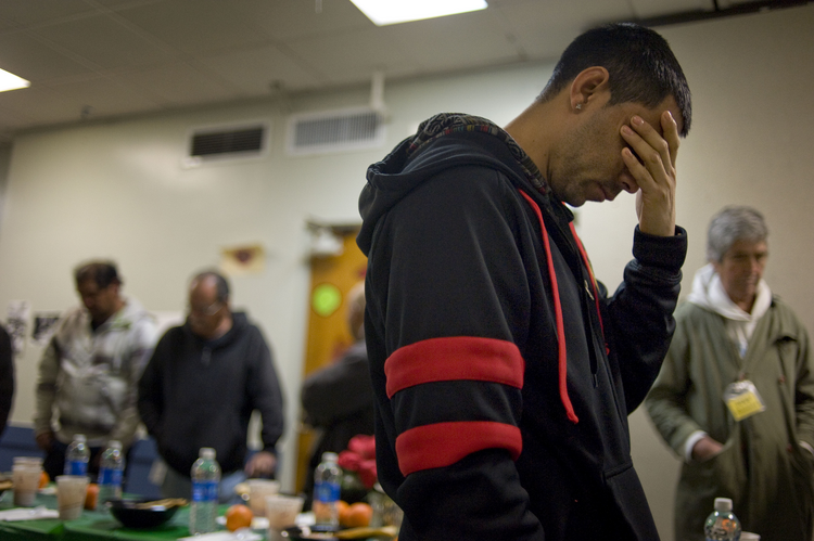 A man prays before dinner in 2014 at the Guadalupanos Homeless Project in Los Angeles. (CNS photo/David Maung, EPA)