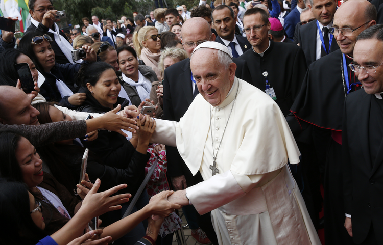 Pope Francis greets the faithful as he arrives to celebrate Mass at the Church of the Immaculate Conception in Baku, Azerbaijan, Oct. 2. (CNS photo/Paul Haring)