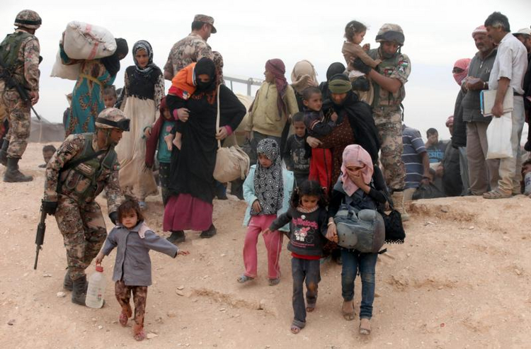 Syrian refugees arrive at a camp after crossing into the Jordanian side of the northeast Jordan-Syria border near Royashed. (CNS photo/Jamal Nasrallah, EPA)