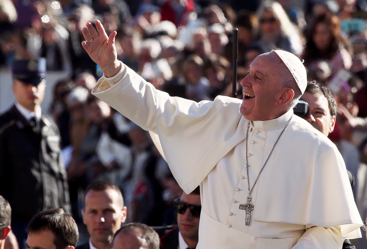 Pope Francis waves as he arrives to lead his Nov. 9 general audience in St. Peter's Square at the Vatican. (CNS photo/Stefano Rellandini, Reuters)