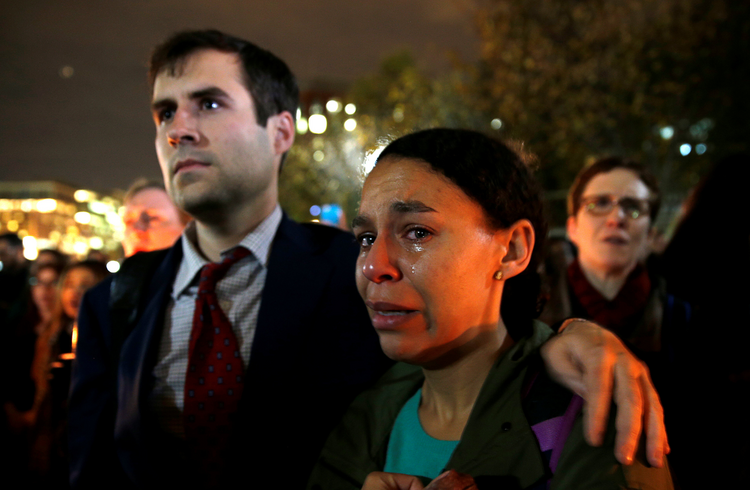 A woman cries while taking part in an anti-Trump vigil in front of the White House in Washington Nov. 9. (CNS photo/Kevin Lamarque, Reuters)