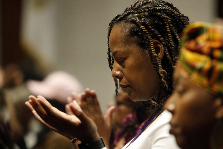 A woman prays during a healing Mass on Nov. 12, 2016, at St. Martha Church in Uniondale, N.Y. The liturgy was celebrated in observance of National Black Catholic History Month. (CNS photo/Gregory A. Shemitz)