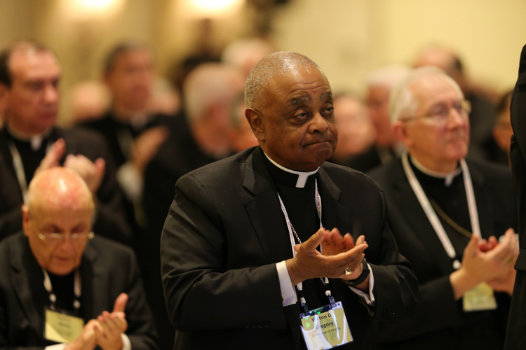 Atlanta Archbishop Wilton D. Gregory, center, and other prelates applaud on Nov. 14 after an address by Archbishop Christophe Pierre, apostolic nuncio to the United States, during the annual fall general assembly of the U.S. Conference of Catholic Bishops in Baltimore. (CNS photo/Bob Roller)
