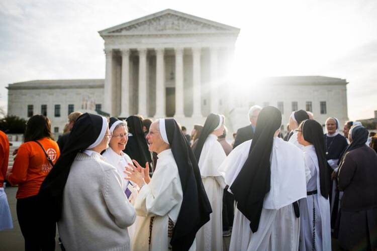 Women religious gather outside the U.S. Supreme Court in Washington on March 23, the day the high court heard oral arguments in religious groups' suit against the Affordable Care Act's contraceptive mandate. (CNS photo/Jim Lo Scalzo, EPA)