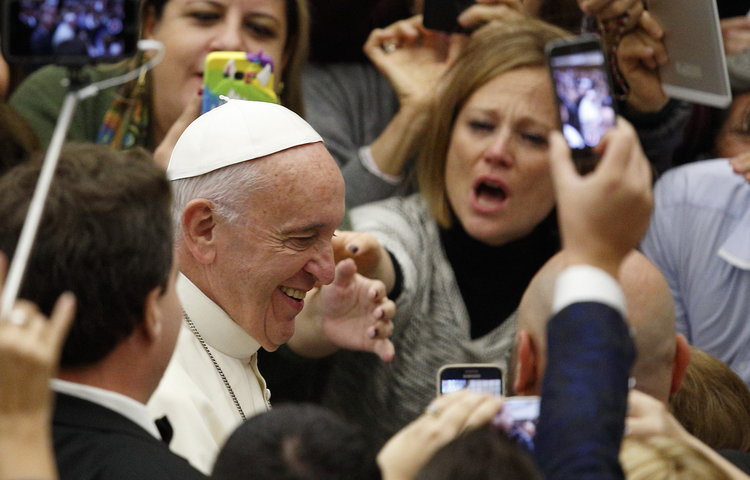 Pope Francis arrives to lead his general audience in Paul VI hall at the Vatican Nov. 23. (CNS photo/Paul Haring)