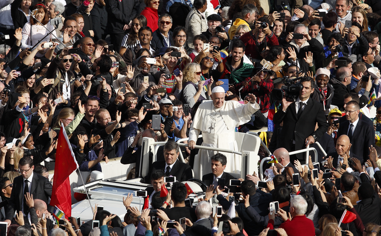 Pope Francis greets the crowd after celebrating the closing Mass of the jubilee Year of Mercy in St. Peter's Square at the Vatican Nov. 20. (CNS photo/Paul Haring)