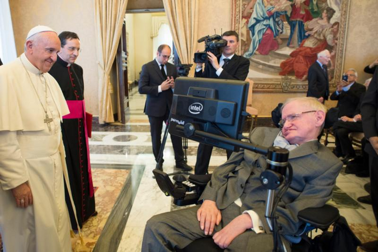 Pope Francis greets British theoretical physicist and cosmologist Stephen Hawking, during an audience with participants attending a plenary session of the Pontifical Academy of Sciences at the Vatican on Nov. 28. (CNS photo/L'Osservatore Romano, handout)