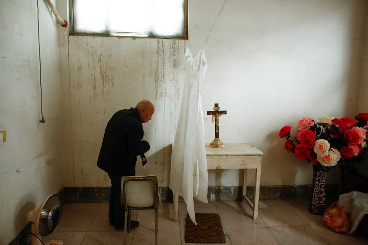 A retired bishop waits to hear confession at an unofficial Catholic church in Youtong village, Hebei Province, China. (CNS photo/Thomas Peter, Reuters)