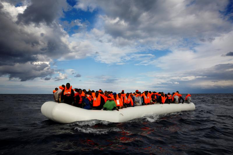 A raft with 112 passengers drifts in the Mediterranean Sea some 36 nautical miles off the Libyan coast on Jan. 2 before being rescued by members of a Spanish nongovernmental organization. (CNS photo/Yannis Behrakis, Reuters)