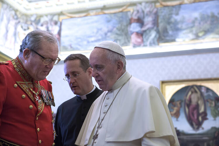 Pope Francis talks with Fra Matthew Festing, grand master of the Sovereign Military Order of Malta, during a private audience with members of the order at the Vatican in this June 23, 2016, file photo. (CNS photo/Maria Grazia Picciarella, pool)