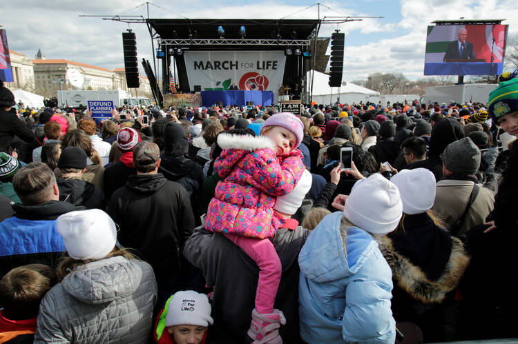 A child rests as U.S. Vice President Mike Pence speaks during a rally at the annual March for Life in Washington Jan. 27. (CNS photo/Yuri Gripas, Reuters)