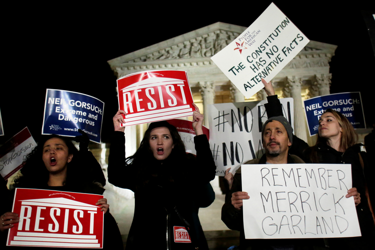 Protesters rally outside the Supreme Court in Washington on Jan. 31 against President Donald Trump's Supreme Court nominee Judge Neil Gorsuch. If confirmed, Gorsuch will fill the seat that has been empty since the death of Justice Antonin Scalia last February. (CNS photo/Yuri Gripas, Reuters)