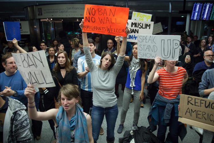 People gather for a protest at the Arrivals Hall of San Francisco's International Airport after people coming in from Muslim-majority countries were held on Jan. 28 by border control as a result of the new executive memorandum by U.S. President Donald Trump. (CNS photo/Peter Dasilva, EPA)