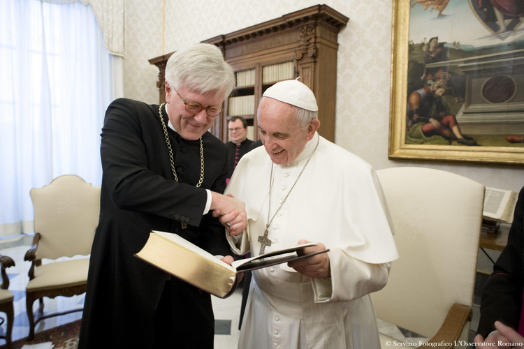 Pope Francis and Bishop Heinrich Bedford-Strohm, chair of the Council of the Evangelical Church in Germany, meet at the Vatican Feb. 6. (CNS photo/L'Osservatore Romano)