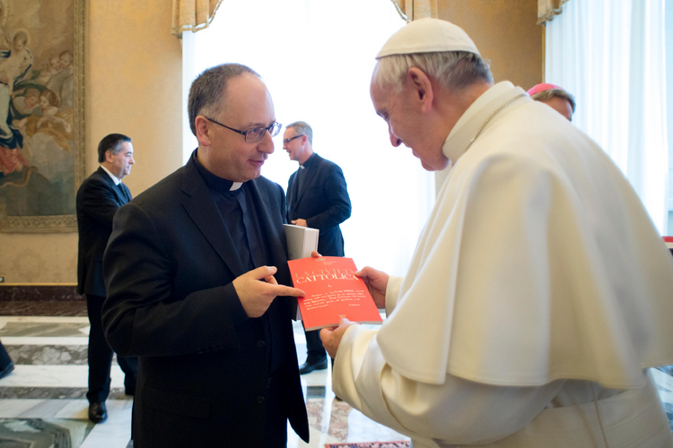 Pope Francis accepts an issue of La Civilta Cattolica from Father Antonio Spadaro, editor of the Jesuit-run magazine, during a Feb. 9 meeting with editors and staff. (CNS photo/L'Osservatore Romano, handout)