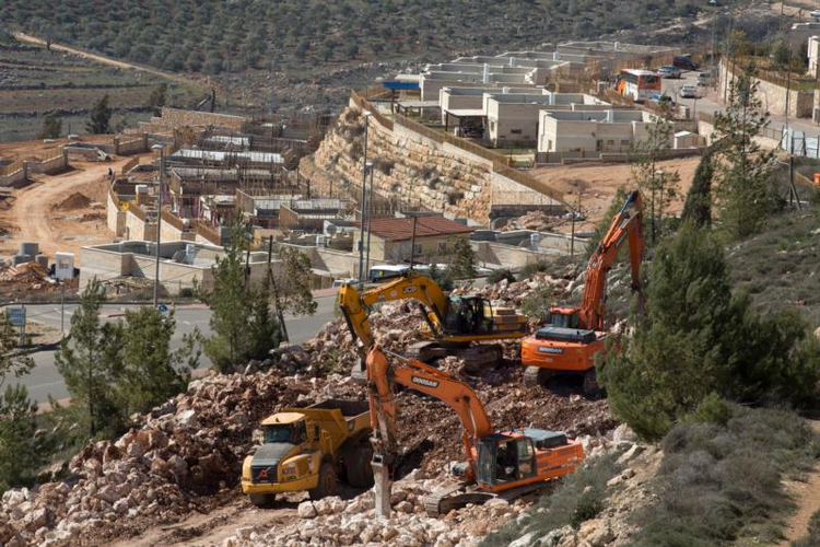 Heavy equipment is seen as workers clear an area for the construction of a new home on Feb. 7 in the Israeli settlement of Shilo, West Bank. (CNS photo/Jim Hollander, EPA)