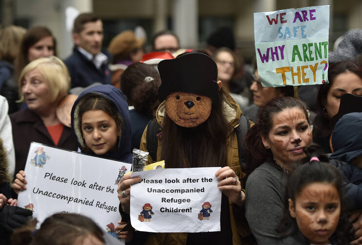 Demonstrators gather during a children's refugee protest in 2016 in London. (CNS photo/Hannah McKay, EPA