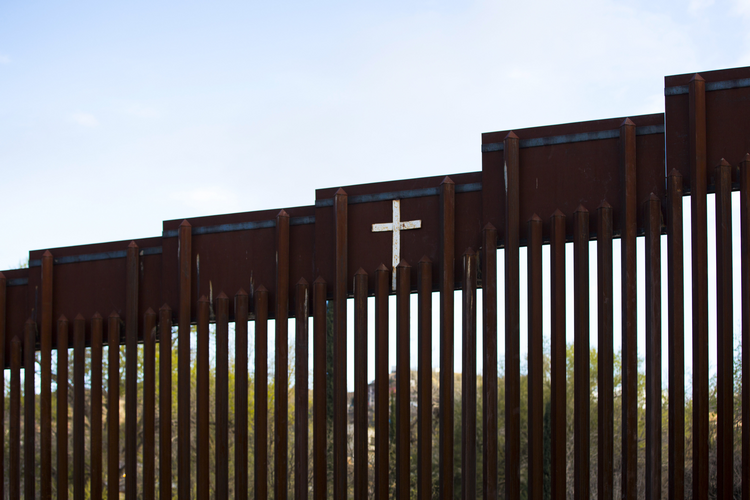 The bollard steel border fence splits the U.S. from Mexico in this view west of central Nogales, Ariz., Feb. 19. (CNS photo/Nancy Wiechec)