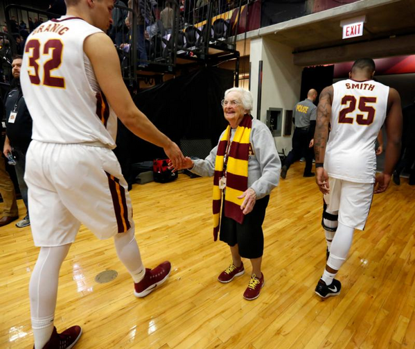 Longtime chaplain of the Loyola University Chicago men's basketball team and campus icon, Sister Jean Dolores Schmidt, 97, greets players after a game on Feb. 12. She is the newest member of the school's sports hall of fame. (CNS photo/Karen Callaway, Chicago Catholic)