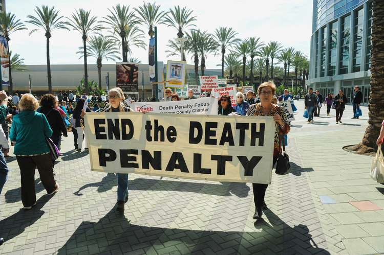 Demonstrators march during a Feb. 25 rally organized by Catholics Against the Death Penalty in Southern California (CNS photo/Andrew Cullen, Reuters).