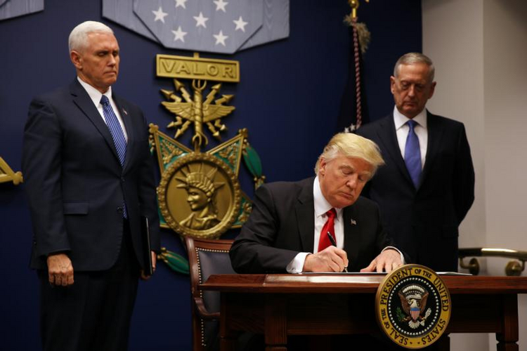 U.S. President Donald Trump signs a revised executive order for a U.S. travel ban on March 6 at the Pentagon in Arlington, Va. (CNS photo/Carlos Barria, Reuters)