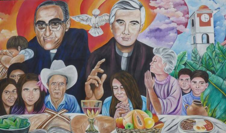 A mural in El Paisnal, El Salvador, seen in this Jan. 29 photo, features Blessed Oscar Romero and town native Father Rutilio Grande, surrounded by rural men, women and children, the community the Jesuit Father Grande served from 1972 until his March 12, 1977, assassination. (CNS photo/Rhina Guidos)