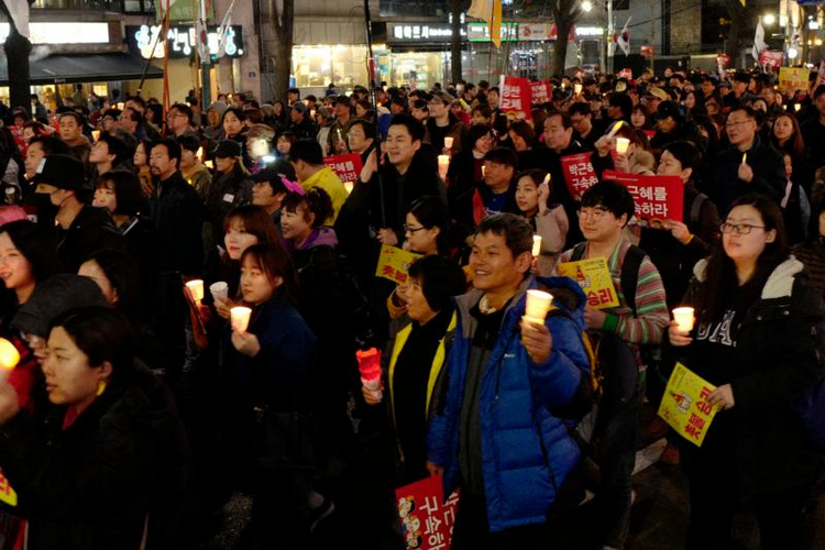 South Koreans gather to celebrate on March 11 after a court upheld the impeachment of South Korean President Park Geun-hye. Catholics in South Korea called for unity following the March 10 ruling. (CNS photo/Jeon Heon-Kyun, EPA)