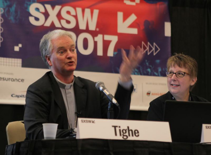 Irish Bishop Paul Tighe, adjunct secretary of the Pontifical Council for Culture, speaks on March 10 during the South by Southwest Festival in Austin, Texas. At right is Helen Osman, a communication adviser. (CNS photo/Matt Palmer)