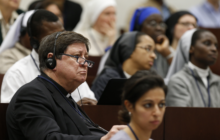 Brazilian Cardinal Joao Braz de Aviz, prefect of the Congregation for Institutes of Consecrated Life and Societies of Apostolic Life, attends a seminar on safeguarding children at the Pontifical Gregorian University in Rome March 23. The seminar was organized by the Pontifical Commission for the Protection of Minors. (CNS photo/Paul Haring)
