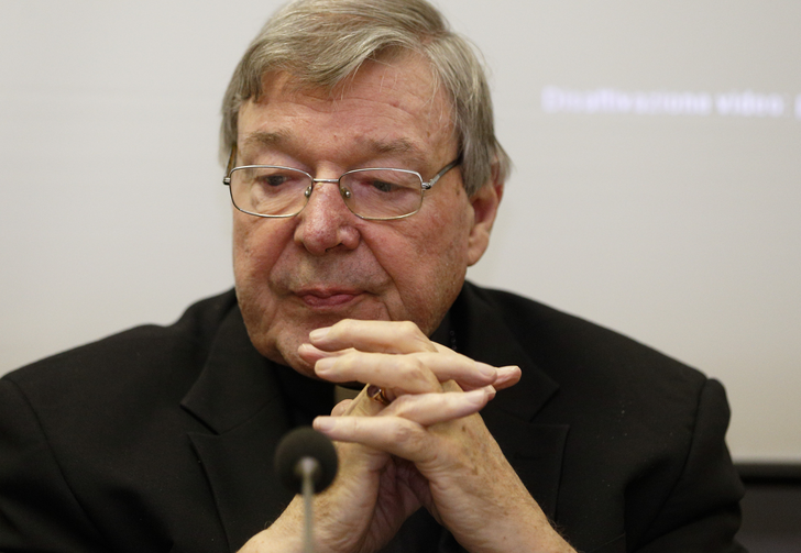 "Australian Cardinal George Pell, prefect of the Vatican's Secretariat for the Economy, attends the presentation of the book, ""Connected World,"" at the Vatican on March 28. (CNS photo/Paul Haring)"