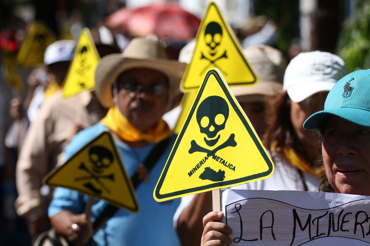 Protesters in San Salvador, El Salvador, demonstrate against mining exploitation March 9. El Salvador passed a law March 29 banning metal mining nationwide, making the small Central American country the first in the world to outlaw the industry.(CNS photo/Oscar Rivera, EPA)