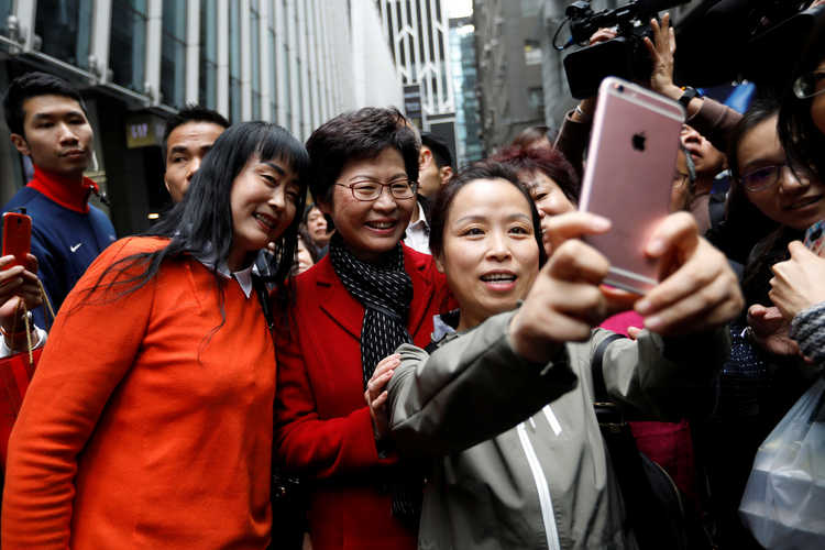 Women take selfies with Carrie Lam on March 27, the day after she was elected Hong Kong's Chief Executive. Lam was chosen as Hong Kong's new leader in the first such vote since 2014, when pro-democracy protests erupted over the semi-autonomous Chinese city's election system. (CNS photo/Tyrone Siu, Reuters)