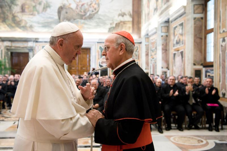 Pope Francis greets Cardinal Ricardo Blazquez Perez of Valladolid, Spain, during an audience with seminarians and faculty of the Pontifical Spanish College of St. Joseph at the Vatican on April 1. (CNS photo/L'Osservatore Romano, handout)