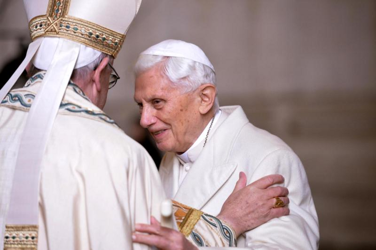 Pope Francis greets retired Pope Benedict XVI in a 2015 file photo. (CNS photo/Maurizio Brambatti, EPA)